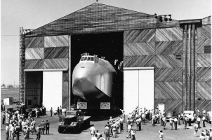 The Hughes Flying Boat is moved out of the Hughes Aircraft assembly building to Terminal Island for final assembly in June, 1946